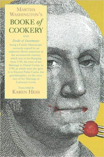 Cover of Martha Washington's Book of Cookery with portrait of George Washington eating a cherry.