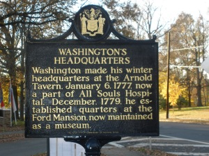 Photo of historic marker: Washington's Headquarters. Washington made his winter headquarters at the Arnold Tavern January 6, 1777 now a part of All Souls Hospital. December 1779 he established quarters at the Ford Mansion now maintained as a museum.